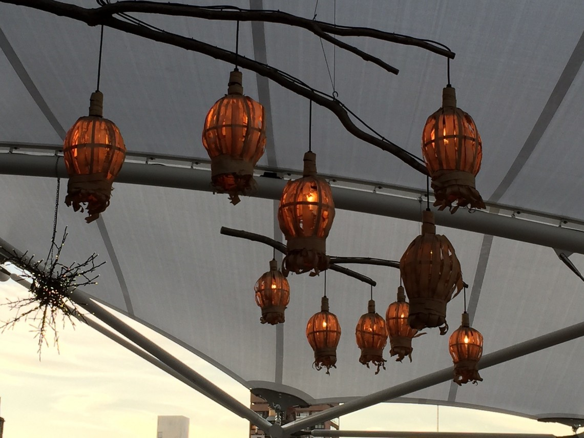 hanging chinese lanterns on the roof top of the firmdale's ham yard hotel in soho london