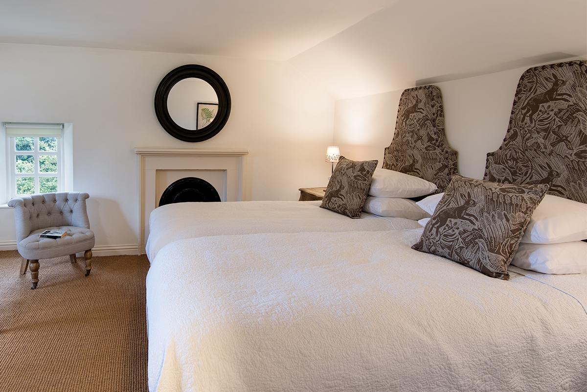 https://talesofthetweed.co.uk/wp-content/uploads/2019/04/Milne-Graden-Garden-House-Holiday-Cottage-Bedroom-mark_Hearld_Hares-fabric