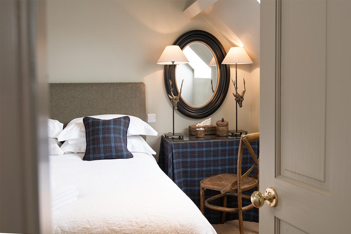 Milne-Graden-School-House-Holiday-Cottage-looking- through-Bedroom-door-blue-tweed-deer-lamps