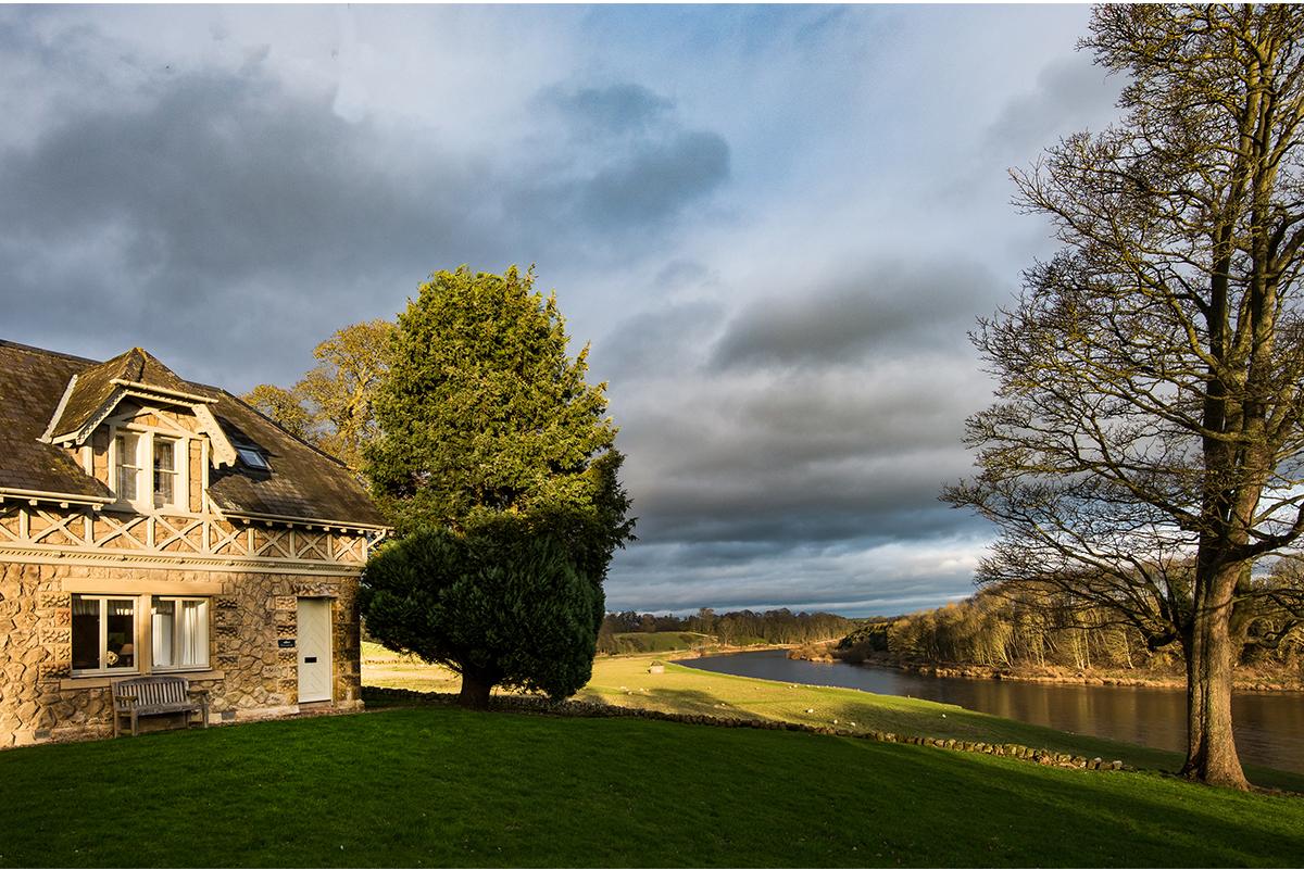 Milne-Graden-Tweedside-Holiday-Cottage-Exterior-front-door-view-of-River-Tweed