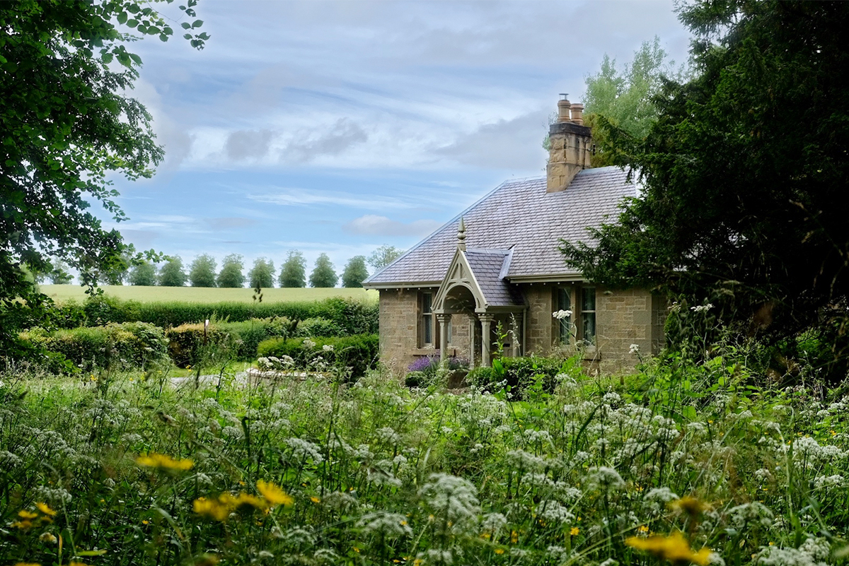 https://talesofthetweed.co.uk/wp-content/uploads/2020/07/Milne-Graden-Summer-looking-at-Park-End-holiday-cottage-through-Wild-Flowers.jpg