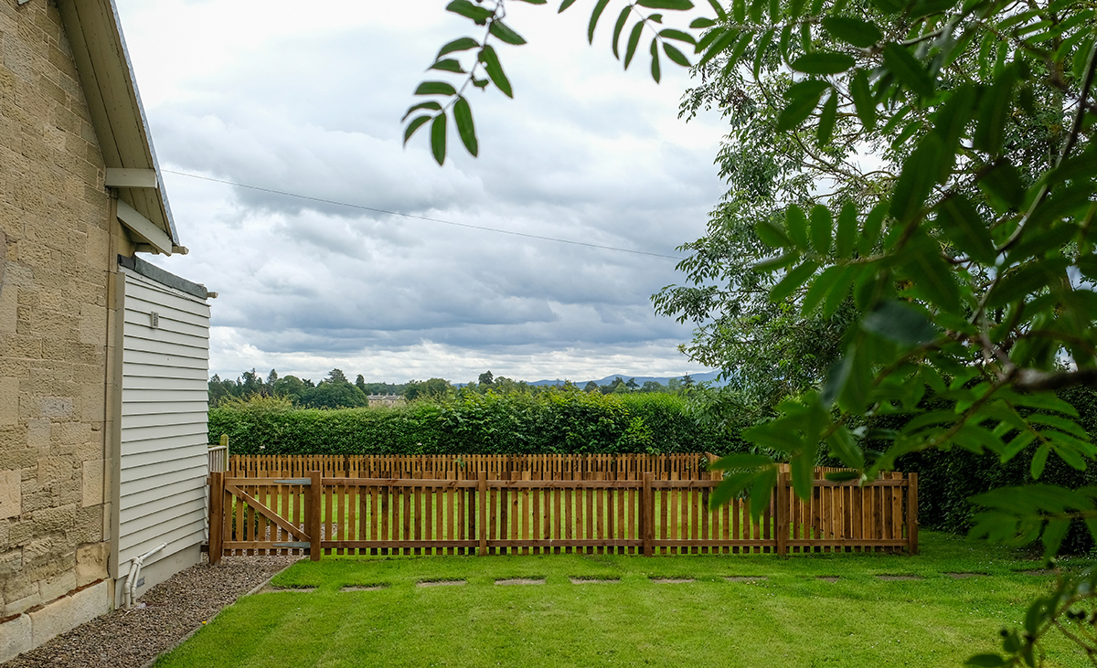 Looking-through-trees-at-North-Lodge-Holiday-Cottage-Enclosed-Dog-Friendly-Garden