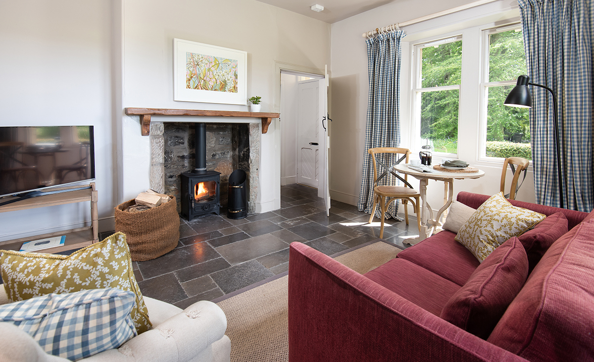 Milne-Graden-Holiday-Cottages-Park-End-view-looking-acorss-lounge-at-Angie-Lewin-print-above_fireplace